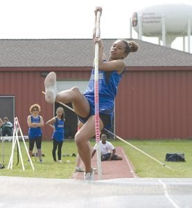 Diamond Scales goes up and over during a pole vault attempt.
