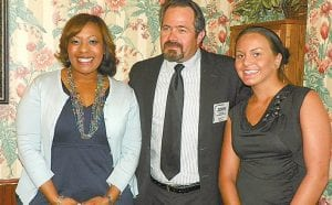 Chrystal R. Harris of Flint and Sarah Ross of Burton are two of the three winners of annual WFBA scholarships with John Folts, chairman of the scholarship committee.