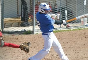 Alex Thompson (#2) swings for the fences earlier this season for the Cavaliers' baseball team.