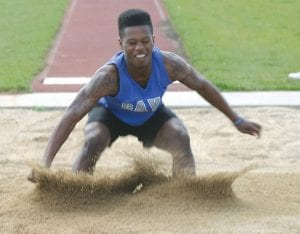 The Cavaliers' Jaylen Randle competes in the long jump for the boys' varsity track and field squad.