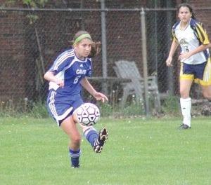 Carman-Ainsworth freshman Melody Bamford (#8) boots the ball earlier this season.