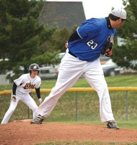 Carman-Ainsworth's Ethan Lambitz checks the runner against West in May.