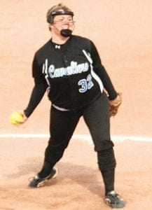 Carman-Ainsworth's Keri Crane goes through the wind up in the circle.