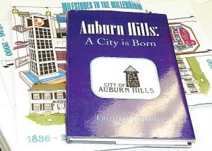 Information gathered by the Name Change committee includes this book written about Pontiac Township changing its name to Auburn Hills in 1983.