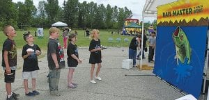 Woodland Elementary students line up for a turn to play one of many carnival games provided during a fun-filled Finale held on the school grounds last week.