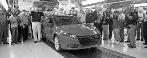 The first 2013 Dodge Dart rolls off the line at Chrysler's Belvidere Assembly Plant.