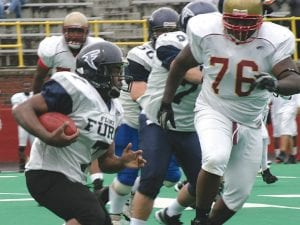 The Fury's Ravon Nunley carries the ball on June 9 against the Detroit Seminoles.