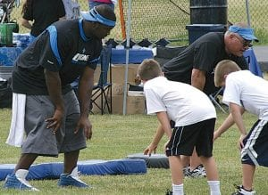 Detroit's Andre Fluellen instructed youngsters at the camp at Grand Blanc.