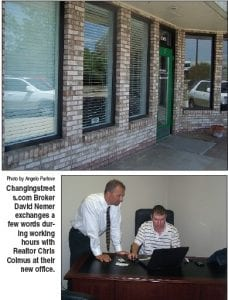Changingstreet s.com Broker David Nemer exchanges a few words during working hours with Realtor Chris Colmus at their new office.