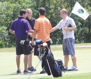 Flint Junior Golf Association players shake hands at the end of the Henrickson Award tournament at Atlas Valley Country Club.