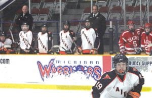 Jon Jepson (back left) watches on as his Flushing hockey team takes on Swartz Creek last season at Perani Arena, home of the Michigan Warriors, which Jepson will now assist.