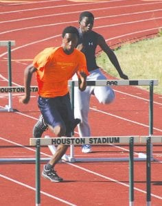 Boys' hurdlers take to the track at Houston Stadium.