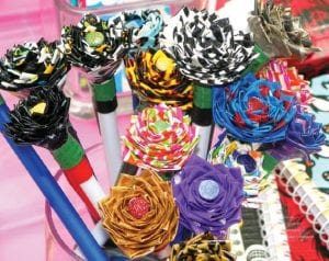 Flower pens made by twins Rebecca and Alyssa Pray of Flushing for their kid's business at the mall.