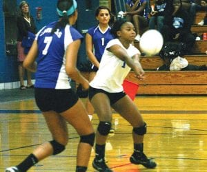Monica Townsend digs a shot from her libero position in a match last season.