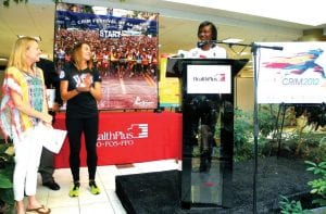 Olympic boxing gold medalist Claressa Shields of Flint (at the podium), runner Geena Gall of Grand Blanc (center) and marathoner Deena Castor were highlighted female athletes at a pre- Crim Race event last week hosted by HealthPlus.