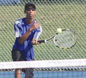 Carman-Ainsworth's Chris Crowder returns a shot during Tuesday's tri-meet at the Lapeer Optimist Community Tennis Courts on the campus of Lapeer West.
