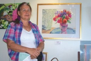 Alicia Marsland with one of her watercolor paintings.