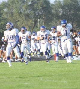 The Carman-Ainsworth football team has stormed to victory in its first three games and is ranked fourth in the first state poll of the season. See sports today for details.