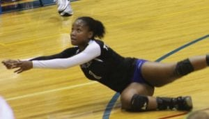 Carman-Ainsworth's Monica Townsend goes to the floor for a dig.
