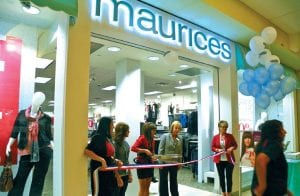NEW MALL STORE — Township supervisor Karyn Miller joined members of the Swartz Creek Chamber of Commerce and the Genesee Regional Chamber of Commerce at the official ribbon-cutting last week for maurices, a new women's clothing store at Genesee Valley Center mall.