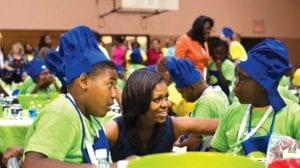 """First lady Michelle Obama at a """"Let's Move Day"""" event in 2011."""