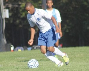 Stefon Clark moves the ball upfield in a game earlier this season.