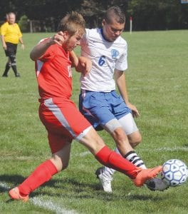 Sheridan Cox (6) battles for ball possession in a game earlier this season.