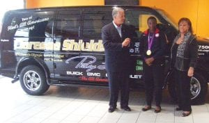 MEET THE CHAMP — Vice President & General Manager, Larry White and Patsy Lou Williamson, presented a customized Chevrolet Express Van to Flint's own 2012 Olympic Gold Medalist Claressa Shields on Sept. 21. Patsy Lou Chevrolet is hosting a a Meet & Greet for the public Sept. 29 where Claressa Shields will be available for photos and autographs from noon to 2 p.m. Patsy Lou Chevrolet is located at The All American Corner, Linden Road at Corunna Road in Flint Township.