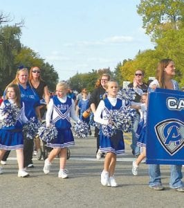 School spirit starts young as demonstrated by these students at the Homecoming Parade.