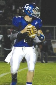 Junior quarterback Connor Storms drops back to pass against Flint Northwestern last week.