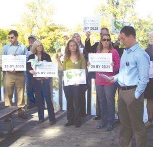 Members of the Sierra Club held a rally this week in support of Proposal 3 at the Flint Farmer's Market.