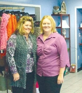 Above, the exterior of Recycled Treasures on Saginaw Street, north of Dort Highway. Brenda Swallow and Laura Nuyen stand inside their newly opened second-hand store.