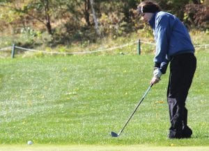 Carman-Ainsworth's Morgan Genore watches her putt at the regional last Thursday.