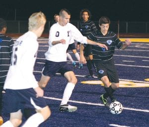 Khaled Zaiter (4) looks to make his move for Carman-Ainsworth against Oxford.