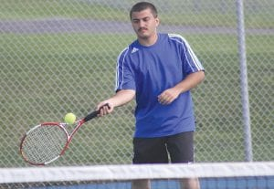 Omeed Hekmati concentrates on a forehand shot at No. 2 Singles.