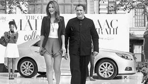 Fashion designer Issac Mirzrahi and EXTRA host Maria Menounos.
