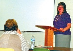 Linda Hamacher, executive director at Genesee Health Plan, speaks last week about the ballot proposal at an event sponsored by the League of Women Voters and Delta Sigma Theta sorority.