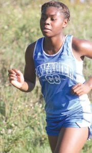 Randi Richardson will look to lead the Carman-Ainsowrth girls' team at the regional meet Saturday.