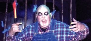 One of the many actors at Burton's Haunted Forest takes the time to put on a scary show for the camera.