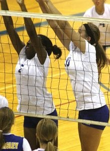 Carman-Ainsworth's Deja Lester and Jessica Smith put up a solid front at the net.