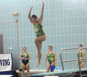 Jennifer Messina begins a dive in a home meet on Oct. 18. against Bay City Western.