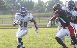Senior running back Gerald Holmes led Carman-Ainsworth to an 8- 2 record and a berth in the Division 1 state playoffs.