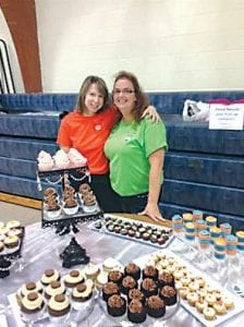 Shawn Ochs (left) Michelle Holland (right) display some of their tempting sweet treats.