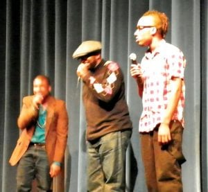Talent show organizer Chane Clingman (center) showcased his vocal talents during a pre-intermission performance.
