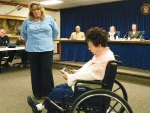 Retiring five-term Flint Township Treasurer Sandra Wright presents token of her appreciation to Deputy Treasurer Tracey Tucker.