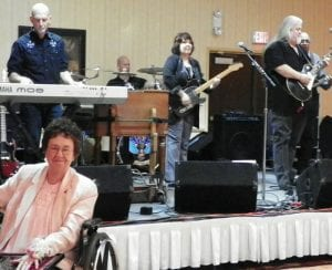 The Rusty Wright Band strikes up a tune during retirement party of his mother Sandra Wright, pictured in the foreground.