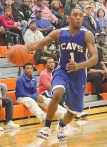 Denzel Watts (#1) drives to the basket for the Cavaliers.