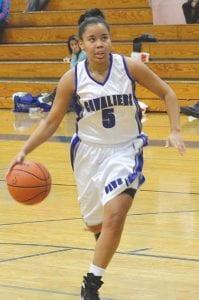 Ashley Hall (#5) fills the lane for the Carman-Ainsworth varsity girls' basketball team.