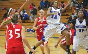 Angel Proby (23) drives for a layup in last Thursday's win over Swartz Creek.