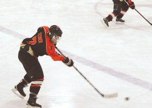 Flushing's Jeffrey Fisher skates up ice with the puck against Goodrich at the Polar Palace.